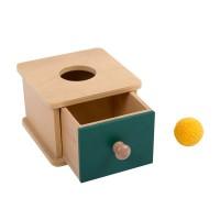 Boîte à formes avec balle tricotée